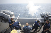 Sailors Perform A 21-gun Salute Aboard Print by Stocktrek Images