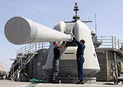 Artillery Gun Prints - Sailors Perform Maintenance On A Mk-45 Print by Stocktrek Images
