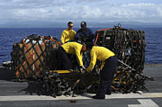 Netting Posters - Sailors Prepare Pallets Of Cargo Aboard Poster by Stocktrek Images
