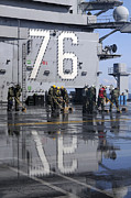 Uss Ronald Reagan Prints - Sailors Scrub The Flight Deck Aboard Print by Stocktrek Images