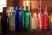 Colorful Bottles Framed Prints - Saloon bottles Framed Print by Toni Hopper