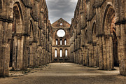 Old Ruins Posters - San Galgano  - a ruin of an old monastery with no roof Poster by Joana Kruse
