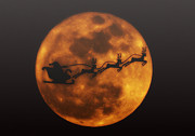 Santa Reindeer Posters - Santa Across the Sky Poster by Bill Cannon
