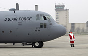 Airfield Prints - Santa Arrives By A C-130 Hercules Print by Stocktrek Images