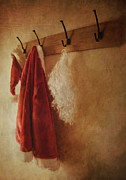 Coat Framed Prints - Santa costume hanging on coat hook Framed Print by Sandra Cunningham