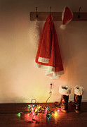 Rack Prints - Santa costume hanging on coat hook with christmas lights Print by Sandra Cunningham