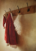 Fur Hat Posters - Santa costume hanging on coat rack Poster by Sandra Cunningham