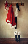 White Coat Prints - Santa costume with boots on coathook Print by Sandra Cunningham