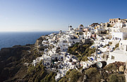 Leda Photography Framed Prints - Santorini Cliff Framed Print by Leslie Leda
