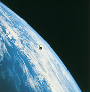 Planet Earth Posters - Satellite In Orbit Around The Earth Poster by Stockbyte
