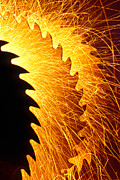 Woodworking Prints - Saw blades with sparks Print by Garry Gay