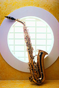 Saxophones Framed Prints - Saxophone in round window Framed Print by Garry Gay