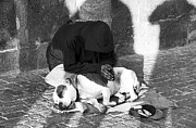 Dog Photographs Photos - Say a Prayer in Prague by John Rizzuto