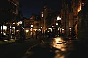 Streetlamps Posters - Scene from French Village Street at Night at Disney Epcot Poster by Purcell Pictures