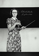 1940-1949 Prints - School Teacher Standing In Front Of Blackboard (1940) Print by Archive Holdings Inc.