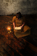 Schoolgirl Sitting On Wood Floor Reading By Candlelight Print by Jill Battaglia
