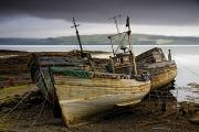 Gloomy Prints - Scotland Three Boats On Shore Print by John Short