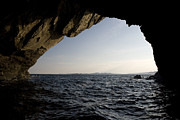 Water Over Rock Photos - Sea Cave Near Irelands Eye by Pete Ryan