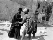 Jerusalem Art - Searching a Greek Priest for Arms 1920 by Munir Alawi