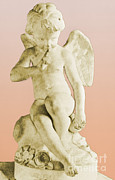 Greek Sculpture Prints - Seated Cupid Print by Photo Researchers