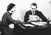 Secretary Assisting Businessman Reading Document At Desk, (b&w) Print by George Marks