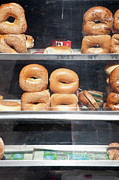 Bread Posters - Selection Of Bagels On Shelves Behind A Shop Window Poster by Paul Hudson