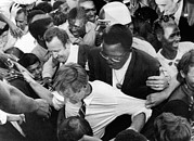 Rfk Photos - Sen. Robert Kennedy Tugged by Everett