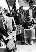 Bobby Kennedy Prints - Sen. Robert Kennedy Worships With Cesar Print by Everett
