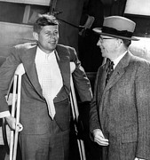 Crutches Posters - Senator John F. Kennedy, On Crutches Poster by Everett