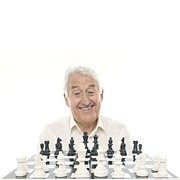 Chess Piece Acrylic Prints - Senior Man Playing Chess Acrylic Print by
