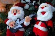 Toy Guitar Posters - Serenading Santas Practice Carols Poster by Keenpress