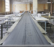 Conveyor Framed Prints - Sewing Line in an Old Factory Framed Print by Magomed Magomedagaev