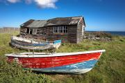 Water Vessels Posters - Shack And Old Boats Poster by John Short