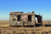 Ramshackle Prints - Shack with American flag Print by John Greim