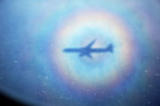 Aeroplanes Framed Prints - Shadow of an aeroplane surrounded by a rainbow halo Framed Print by Sami Sarkis
