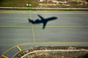 Aeroplanes Framed Prints - Shadow of an airplane taking off Framed Print by Sami Sarkis