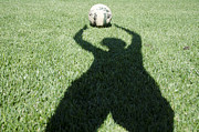 Ball Game Prints - Shadow playing football Print by Mats Silvan