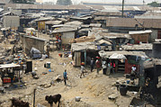 Shanty Prints - Shanty Town, Nigeria Print by Johnny Greig