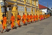 Monks Posters - Sharing food with Buddhist monks  Poster by Nabil Kannan