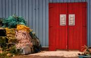 Red Doors Photos - Shed doors and tangled nets by Louise Heusinkveld