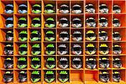Sports Clothing Framed Prints - Shelves Filled With Helmets For Hire Framed Print by Corepics