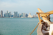 Doha Photo Framed Prints - Ship and doha skyline Framed Print by Paul Cowan