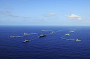 Ronald Reagan Photo Prints - Ships From The Ronald Reagan Carrier Print by Stocktrek Images