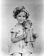 Shirley Temple Posters - Shirley Temple With A Shirley Temple Poster by Everett