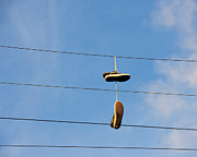 Urban City Areas Photos - Shoes Hanging from Power Line by David Buffington