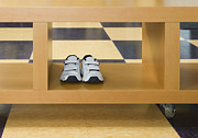 Linoleum Framed Prints - Shoes in a Shelving Unit Framed Print by Andersen Ross