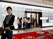 Peoples Republic Of China Photos - Shoppers Await Entry Into The Louis by Justin Guariglia