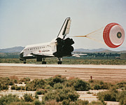 Space Shuttle Endeavour Posters - Shuttle Landing With Brake Chute Poster by Nasa