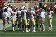 Football Coach Photos - Side Line Huddle by Allen Simmons