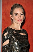 Hair Bun Posters - Sienna Miller Wearing A Balmain Dress Poster by Everett